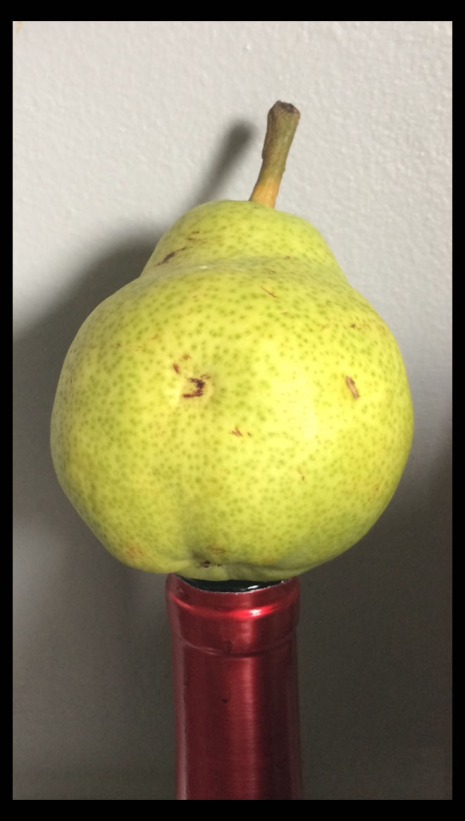 pear on wine bottle